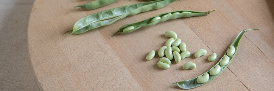 Fresh shell beans on a cutting board.