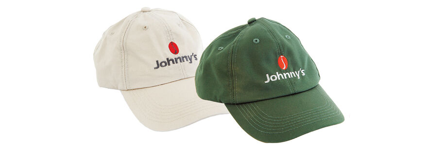 White and green Johnny's Selected Seeds baseball caps.