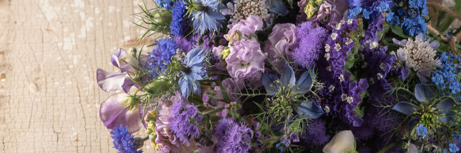 Bouquet of blue and lavender flowers.