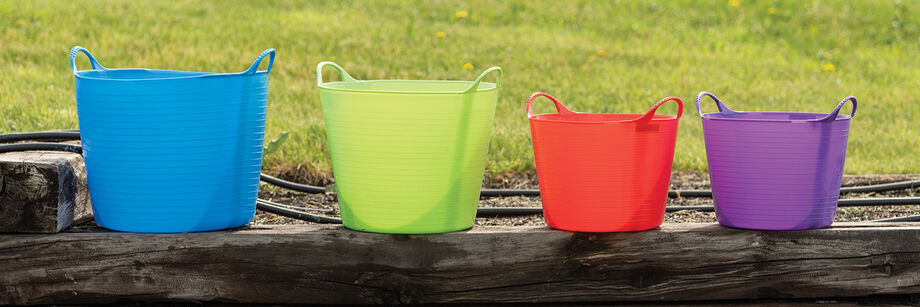 Four Gorilla Tubs (formerly Tubtrugs) in different colors and sizes.
