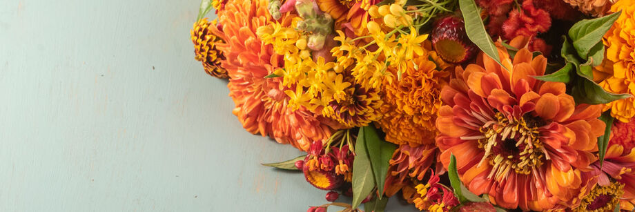 Bouquet of flowers in orange, coral, and pink.