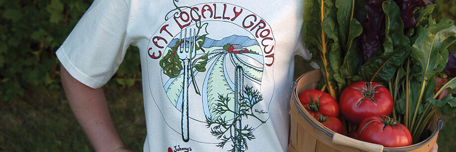 A t-shirt that has the words, eat locally grown.