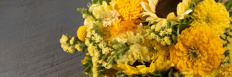 A bouquet of yellow and gold colored cut flowers.