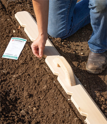 The Notched Cedar Planting Board is especially useful in small spaces where it's easiest to hand-sow your seeds.